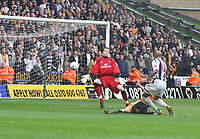 Photo: Mark Stephenson.<br /> Wolverhampton Wanderers v West Bromwich Albion. Coca Cola Championship. Play off Semi Final, 1st Leg. 13/05/2007.West Brom's Diomansy Kamara puts the ball past Wolves keeper Wayne Hennessey