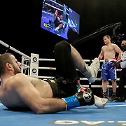 HOLLYWOOD, FL - APRIL 17:  Mahammadrasul Majidov lays on the ground with a broken ankle as Andrey Fedosov looks on at Seminole Hard Rock Hotel & Casino on April 17, 2021 in Hollywood, Florida. (Photo by Alex Menendez/Getty Images) *** Local Caption *** Mahammadrasul Majidov; Andrey Fedosov