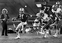 Oakland Raiders Cliff Branch chased by San Francisco 49ers.......(1973  photo/Ron Riesterer)