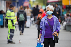 © Licensed to London News Pictures. 19/05/2021. London, UK. Members of the public walk through the High Street in Hounslow, West London, as it is one of 23 areas where the Indian variant of the virus is dominant in the UK. Photo credit: Marcin Nowak/LNP