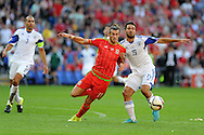 Gareth Bale of Wales holds off Israel's Orel Dgani. Euro 2016 qualifying match, Wales v Israel at the Cardiff city stadium in Cardiff, South Wales on Sunday 6th Sept 2015.  pic by Andrew Orchard, Andrew Orchard sports photography.