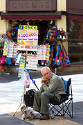 Lotto Lottery ticket seller with dog in Calle Ancha main street, Leon, Castilla y Leon, Spain