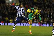 WBA's Stephane Sessegnon (l) challenges Josh Murphy of Norwich. Barclays Premier league, West Bromwich Albion v Norwich city at the Hawthorns in West Bromwich, England on Sat 7th Dec 2013. pic by Andrew Orchard, Andrew Orchard sports photography.