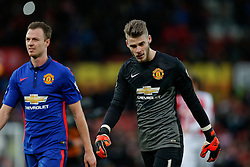 Phil Jones and David De Gea of Manchester United look dejected after the match finishes with a 1-1 draw - Photo mandatory by-line: Rogan Thomson/JMP - 07966 386802 - 01/01/2015 - SPORT - FOOTBALL - Stoke-on-Trent, England - Britannia Stadium - Stoke City v Manchester United - New Year's Day Football - Barclays Premier League.