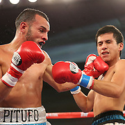 ORLANDO, FL - OCTOBER 04: Christopher Diaz of Puerto Rico (L)  catches Francisco Camacho of Mexico with a left hook during a professional featherweight boxing match at the Bahía Shriners Auditorium & Events Center on October 4, 2014 in Orlando, Florida. (Photo by Alex Menendez/Getty Images) *** Local Caption *** Christopher Diaz; Francisco Camacho