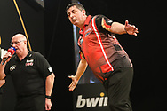 Mensur Suljovic hits a 167 checkout and celebrates during the 2018 Grand Slam of Darts at Aldersley Leisure Village, Wolverhampton, United Kingdom on 16 November 2018. Picture by Shane Healey.