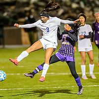Socorro Warrior Danielle Moore (3), left, and Kirtland Central Bronco Kayla Miller (1)  vie for a possession during a quarterfinal match in the state soccer tournament at the Albuquerque Public Schools soccer complex in Albuquerque Thursday.