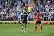 Peter Odemwingie of Stoke city smiles as the Cardiff fans taunt him. Barclays Premier league match, Cardiff city  v Stoke city at the Cardiff city stadium in Cardiff, South Wales on Saturday 19th April 2014. pic by Andrew Orchard, Andrew Orchard sports photography,
