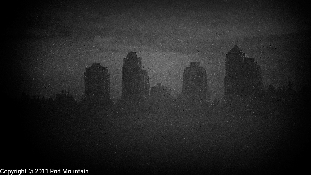 Distant towers appear in silhouette on a foggy morning. Photo: © Rod Mountain