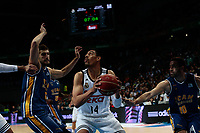 SPAIN, Madrid: Real Madrid's Mexican player Gustavo Ayon and Ucam Murcia´s Spanish player Jose Angel Antelo Paredes during the Liga Endesa Basket 2014/15 match between Real Madrid and Ucam Murcia, at Palacio de los Deportes in Madrid on November 16, 2014