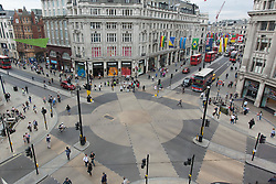 © licensed to London News Pictures. London, UK 01/08/2012. Oxford Circus, London's one of the main shopping and touristic destinations, has considerably less vehicle and pedestrian traffic during the Olympics, pictured on 01/08/12.  Photo credit: Tolga Akmen/LNP