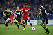 Tom Adeyemi of Cardiff city (c) makes a break. Skybet football league championship match, Cardiff city v Middlesbrough at the Cardiff city stadium in Cardiff, South Wales on Tuesday 16th Sept 2014<br /> pic by Andrew Orchard, Andrew Orchard sports photography.