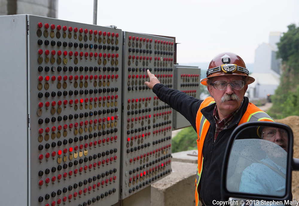 Safety Director Steve Stroschein (left) talks with Owner Kyle Pattison before they enter the mine at Pattison Sand Company in Garnavillo, Iowa on June 5, 2013. Every person who enters the mine has a number and the light board identifies which workers are currently in the mine.