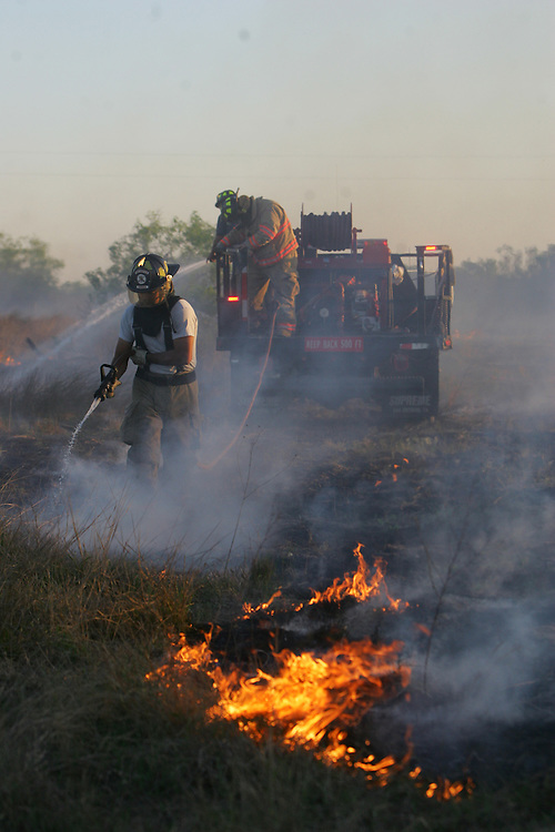 San Manuel, TX - 19 Mar 2008 -.Edcouch Fire Department firefighter Johnny Gonzalez extinguishes a fire line on a ranch north of FM 1017 on Wednesday morning..Photo by Alex Jones / ajones@themonitor.com
