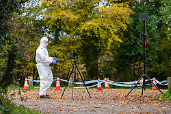 © Licensed to London News Pictures. 24/10/2020. Watlington Hill, UK. A forensic investigator photographs the crime scene in a carpark at the Watlington Hill National Trust Estate. A murder investigation has been launched by Thames Valley Police after the body of a woman in her sixties was located in woodland in the Watlington Hill National Trust Estate at approximately 5:53pm on Friday 23/10/2020. Photo credit: Peter Manning/LNP