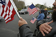 Members of the Patriot Guard Riders salute the hearst carrying Lance Cpl. Michael L. Ford a New Bedford marine that was killed in Iraq when the tank he was operating ran over an explosive device before the funeral service was held at Church of Jesus Christ of Latter Day Saints in North Dartmouth, MASS and the burial was then held at the National Cemetary in Onset, MASS.  Marine Lance Cpl. Michael L. Ford 19, of New Bedford, Mass.; assigned to the 1st Tank Battalion, 1st Marine Division, I Marine Expeditionary Force, Twentynine Palms, Calif.; killed April 26 while conducting combat operations against enemy forces in Anbar province, Iraq.