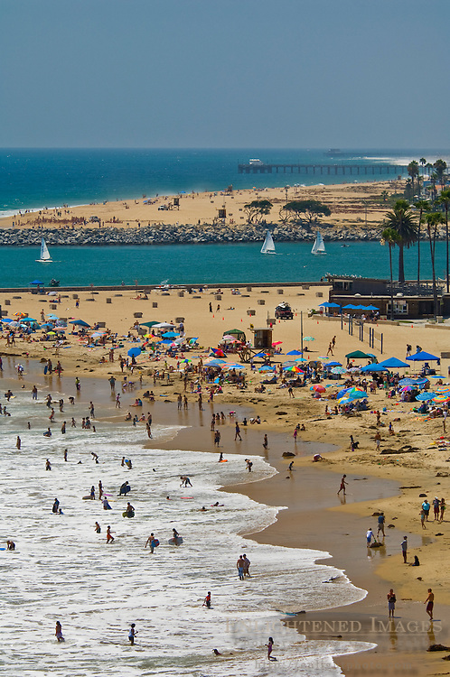 Crowded beach full of people in Summer at Corona del Mar, Newport Beach, Orange County, California
