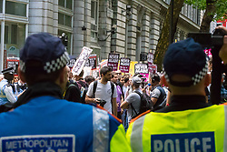 London, June 24th 2017. Anti-fascist protesters counter demonstrate against a march to Parliament by the far right anti-Islamist English Defence League. PICTURED: Polickeep watch as anti-fascists march down Northumberland Avenue towards their allocated position on Victoria Embankment.