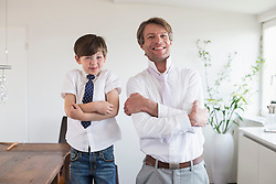 Portrait of father and son, smiling