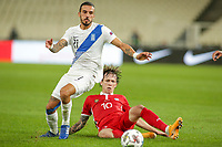 ATHENS, GREECE - OCTOBER 11: Dimitris Kourbelisof Greece and Eugeniu Cociucof Moldova during the UEFA Nations League group stage match between Greece and Moldova at OACA Spyros Louis on October 11, 2020 in Athens, Greece. (Photo by MB Media)