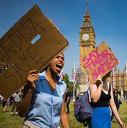 London, June 21st 2017. Protesters march through London from Sheherd's Bush Green in what the organisers call 'A Day Of Rage' in the wake of the Grenfell Tower fire disaster. The march is organised by the Movement for Justice By Any Means Necessary and coincides with the Queen's Speech at Parliament, the destination. PICTURED: A woman chants slogans in Parliament Square.
