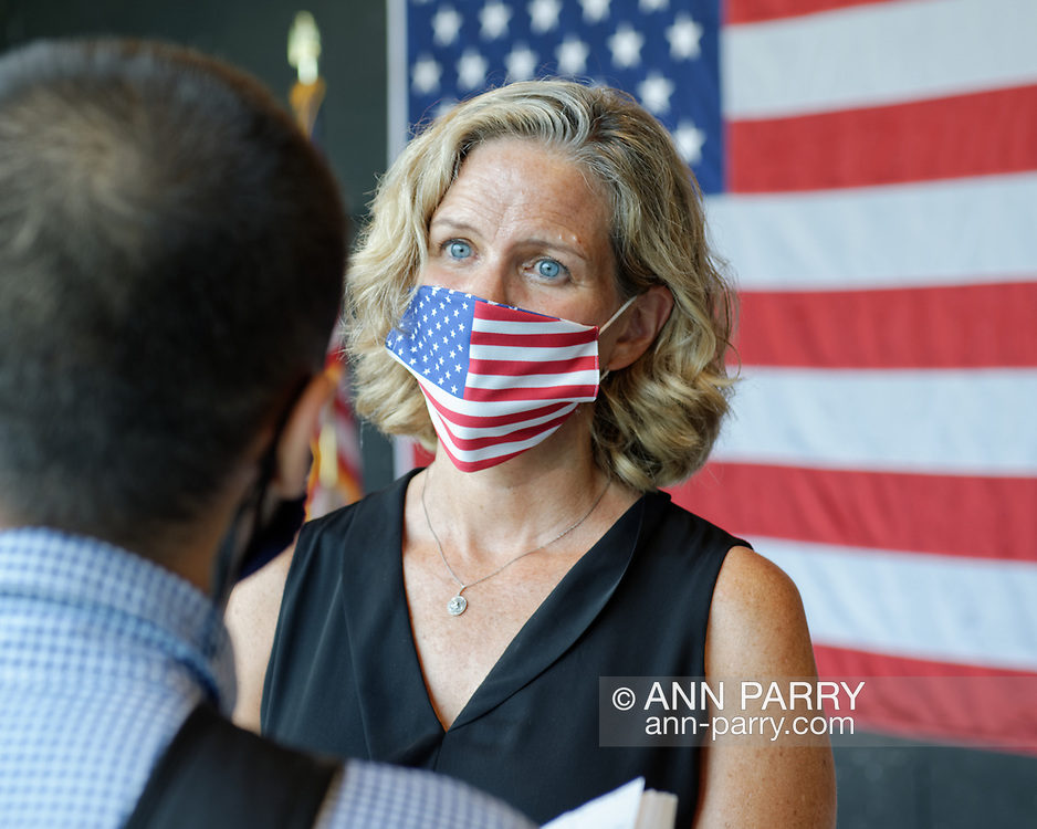 East Meadow, New York, U.S. September 10, 2020. Nassau County Executive LAURA CURRAN wears a face mask with American flag design, while speaking with reporter, after the county event commemorating 19th anniversary of September 11 terrorist attacks with Remembrance Ceremony at Eisenhower Park, with names read of 348 county residents killed that day. Event was held at Harry Chapin Lakeside Theater, instead of 9/11 Memorial across the pond, because of rain prediction.