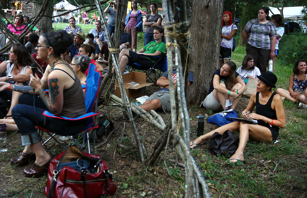 Musician Michelle Shocked, bottom right, listens as Denver pastor and author Nadia Bolz-Weber, at left in chair, speaks with a group in an outdoor geodesic dome at the Wild Goose Festival at Shakori Hills in North Carolina June 23, 2011.  (Photo by Courtney Perry)