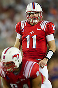 DALLAS, TX - AUGUST 30: Garrett Gilbert #11 of the SMU Mustangs calls a play at the line of scrimmage against the Texas Tech Red Raiders on August 30, 2013 at Gerald J. Ford Stadium in Dallas, Texas.  (Photo by Cooper Neill/Getty Images) *** Local Caption *** Garrett Gilbert