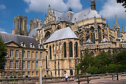 The Reims Cathedral: seen from behind with a man running, Reims, Champagne, Marne, Ardennes, France