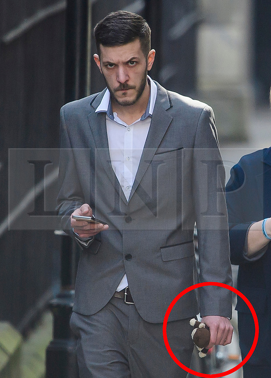 © Licensed to London News Pictures. 03/04/2017. London, UK. CHRIS GARD holding a soft toy monkey as he arrives at the The Royal Courts of Justice in London where a High Court judge is due to rule whether doctors can withdraw life-support treatment to their son, Charlie, who suffers from a rare genetic condition. Doctors at Great Ormond Street Hospital in London say eight-month-old Charlie should be left to die in dignity, but his parents have raised £1.2 million for specialist treatment in America.  Photo credit: Ben Cawthra/LNP