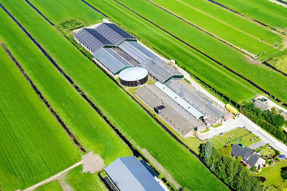 Nederland, Utrecht, Krimpenerwaard, 10-06-2015; Polder Cattenbroek, ten zuidoosten van Woerden. Megastallen voor koeien achter boerderij.<br /> Mega stables for cows behind farm in Hollands Green Hart.<br /> <br /> luchtfoto (toeslag op standard tarieven);<br /> aerial photo (additional fee required);