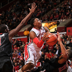 Rutgers Scarlet Knights guard Myles Mack (4) drives to the basket over St. John's Red Storm guard D'Angelo Harrison (11) during Big East NCAA Basketball action between the Rutgers Scarlet Knights and St. John's Red Storm at the Louis Brown Rutgers Athletic Center (RAC) in Piscataway, N.J. Rutgers defeated St. John's 61-58.
