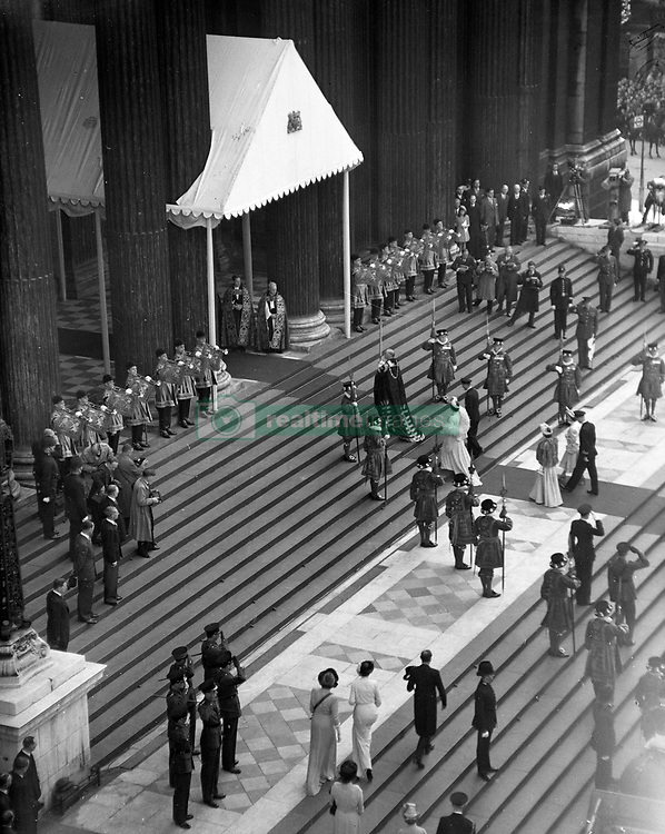 State trumpeters sound a fanfare as King George VI and Queen Elizabeth followed by Princess Elizabeth and the Duke of Edinburgh.