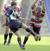 Reading, Berkshire, 21st September 2003, Zurich Premiership Rugby  London Irish v Gloucester Rugby,  Madejski Stadium, <br /> [Mandatory Credit; Peter Spurrier/Intersport Images]Zurich Premiership Rugby - London Irish v Gloucester.<br /> Ball added<br /> Alex Brown charge's down Barry Everitts kick