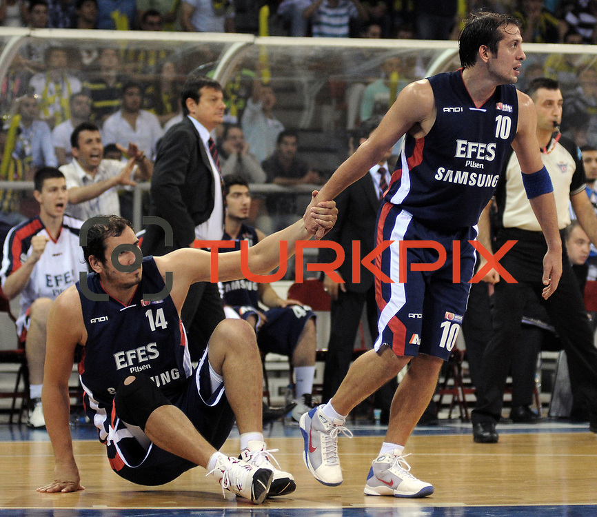 Efes Pilsen's Kerem TUNCERI (R), Kaya PEKER (L) during their Turkish Basketball league Play Off Final third leg match Fenerbahce Ulker between Efes Pilsen at the Abdi Ipekci Arena in Istanbul Turkey on Tuesday 25 May 2010. Photo by TURKPIX