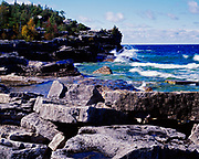 Waves breaking against rocky shore of Georgian Bay, Lake Huron west of Indian Head Cove, Bruce Trail, Bruce Peninsula National Park, Ontario, Canada.