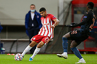 PIRAEUS, GREECE - NOVEMBER 25: Bruma of Olympiacos FC and Benjamin Mendy of Manchester City during the UEFA Champions League Group C stage match between Olympiacos FC and Manchester City at Karaiskakis Stadium on November 25, 2020 in Piraeus, Greece. (Photo by MB Media)