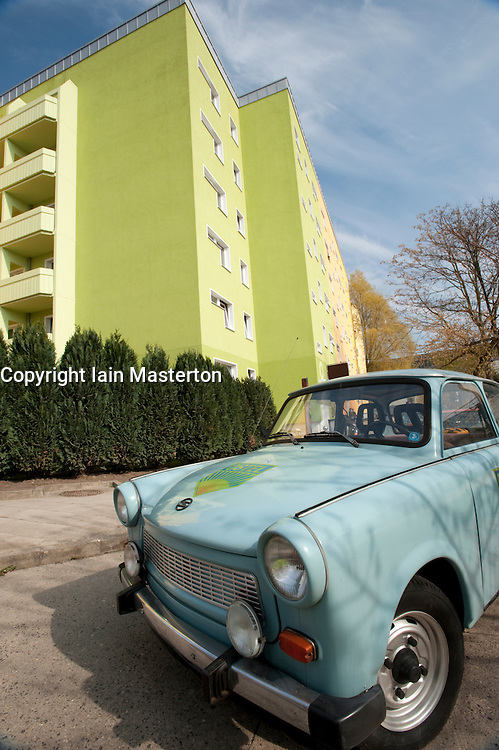 Trabant car parked outside East German themed hotel called  Ostel in Friedrichshain in Berlin Germany
