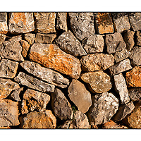 Hand made stone wall in the sun, Mallorca, Spain,
