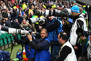 Photographers congregate near the tunnel entrance at Twickenham before the Investec series international between England and Australia at Twickenham, London, on Saturday 13th November 2010. (Photo by Andrew Tobin/SLIK images)