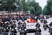 Pope John Paul II during his historic visit to Paris in 1980 travels in motorcade with light minimal security of open top car with police escort motorcycle outriders