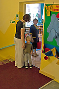 Mom picking up son at Rainbow Preschool Teczowe Przedszkole Balucki District Lodz Central Poland