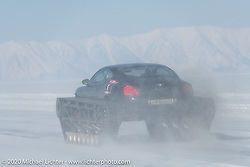 Academeg (Konstantin Zarucki), a YouTuber with 4.3 million subscribers driving his Bentley Continental Ultratank, a Continental (new Continentals start at $202,000!) that he modified with winter tracks for the Baikal Mile Ice Speed Festival. Maksimiha, Siberia, Russia. Friday, February 28, 2020. Photography ©2020 Michael Lichter.