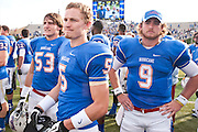 Dec 1, 2012; Tulsa, Ok, USA; Tulsa Hurricanes linebacker Jake Sizelove (53) wide receiver Malachi Blankenship (5) and quarterback Dane Evans (9) wait for a call during a game against the University of Central Florida Knights at Skelly Field at H.A. Chapman Stadium. Tulsa defeated UCF 33-27 in overtime to win the CUSA Championship. Mandatory Credit: Beth Hall-USA TODAY Sports