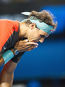 Rafael Nadal shows pain in between serves during play. Stanislaus Wawrinka of Switzerland defeated the number one player in the world R. Nadal of Spain to claim the 2014 Australian Open Men's Singles Championship. The Swiss won 6-3 6-2 3-6 6-3 in a match that will be remembered for a confusing and sometimes bizarre final three sets, with Nadal clearly hampered by a left lower back injury and seemingly on the verge of retirement in the second set.. The match was held on center court at Melbourne's Rod Laver Arena.