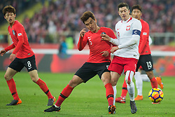 March 27, 2018 - Chorzow, Poland - Jae-sung Lee (KOR), Hyun-soo Jang (KOR) vie Robert Lewandowski of Poland during the international friendly soccer match between Poland and South Korea national football teams, at the Silesian Stadium in Chorzow, Poland on 27 March 2018. (Credit Image: © Foto Olimpik/NurPhoto via ZUMA Press)