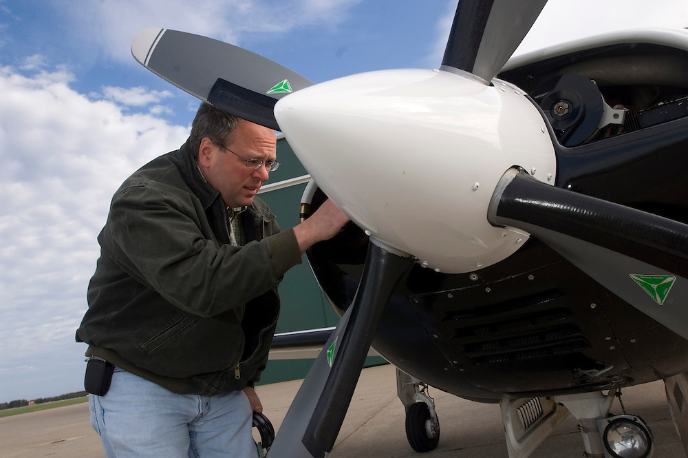 A pilot of a small airplane with his plane