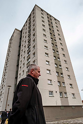 EMBARGOED UNTIL 00:01 24 April 2019<br />Pictured: Local Senior Officer Kenny Rogers contempl;ates the 15 story high Wauchope House<br /><br /><br />Today, Community Safety minister Ash Denham launched the Scottish Government's consultation on Strengthening Fire Safety for High Rise Domestic Buildings following the Grenfell Tower fire in London.  Ms Denholm was joined by Assistant Chief Fire Officer Ross Haggart and Mark McHale, building manager of Wauchope House, <br /><br /><br />Ger Harley | EEm 23 April 2019