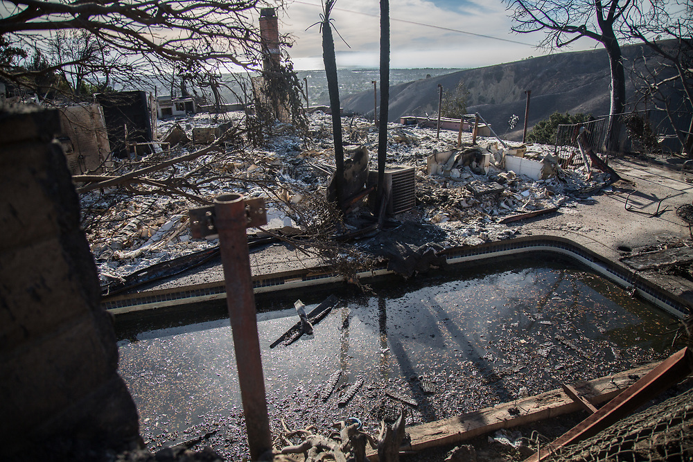 Burned house and pool filled with rubble from Ventura fire occured in Ventura County. On Saturday, December 10th, 2017 at Foothill Blvd in Ventura, California. (Photo by Yuki Iwamura)