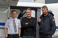 Steindor Kristinn Jonsson (pilot), Mark Carwardine (photographer) and Heimir Hardarson (whale spotter) with plane used for Wild Wonders of Europe mission, Husavik, northern Iceland